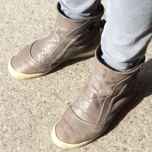 A pair of beige ankle boots.