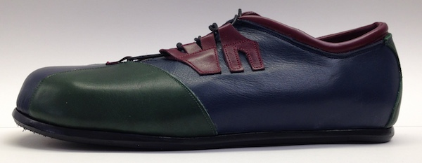 Blue, green and red leather shoe photographed from the side