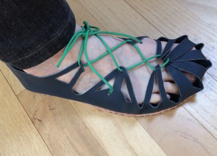 Blue open sandal with green nylon lace