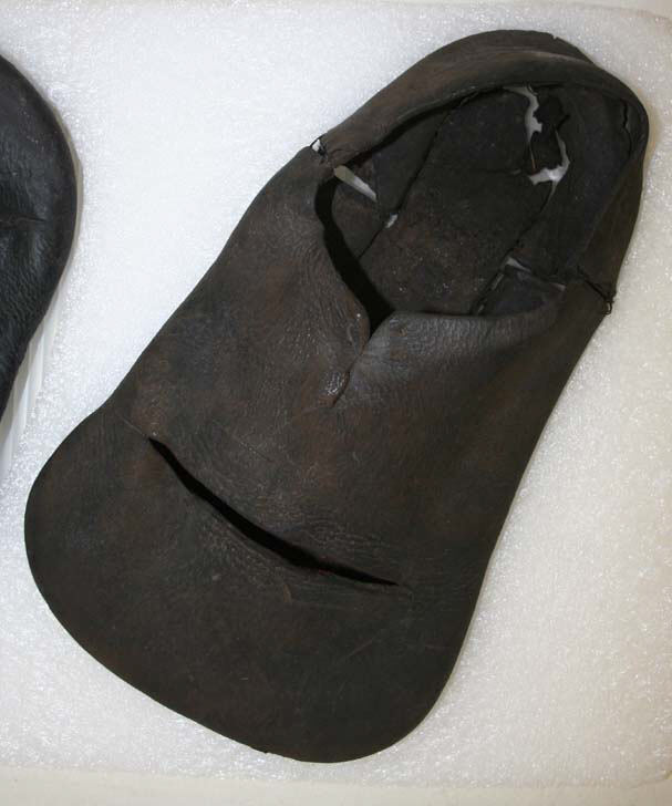 A brown leather laceless shoe with a shovel-shaped toe