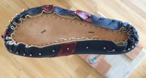 A leather upper nailed to the last